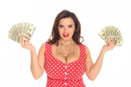 smiling plus size woman with lot of cash isolated on white
