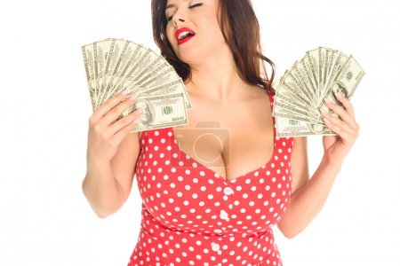 satisfied plus size woman with lot of cash isolated on white