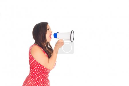 side view of angry plus size woman shouting at loudspeaker isolated on white