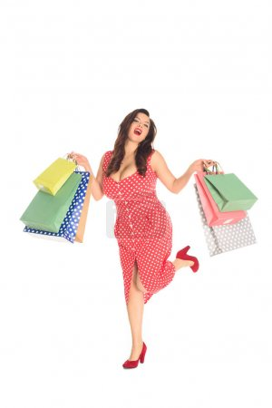 happy plus size woman holding colorful shopping bags isolated on white