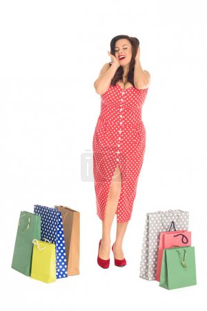 happy plus size woman with colorful shopping bags isolated on white