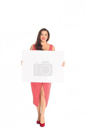 smiling plus size woman holding blank placard isolated on white