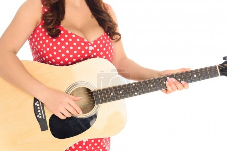 cropped shot of plus size woman playing acoustic guitar isolated on white