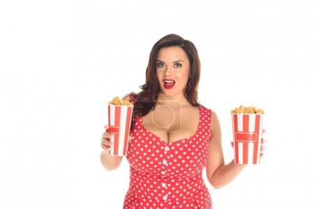 excited plus size woman with boxes of popcorn isolated on white