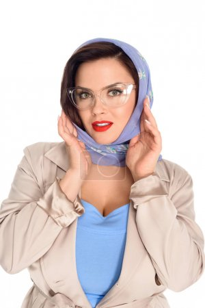 close-up portrait of stylish young woman in kerchief and stylish eyeglasses isolated on white