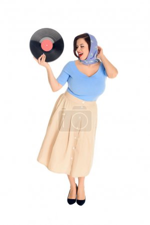 smiling stylish pin up woman holding vinyl record isolated on white