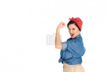 excited pin up woman showing biceps and looking at camera isolated on white