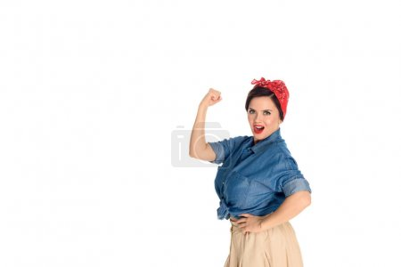 confident pin up woman showing biceps and looking at camera isolated on white