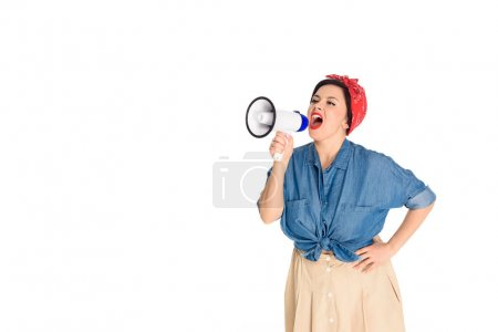 emotional pin up woman standing with hand on waist and yelling at megaphone isolated on white
