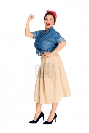 full length view of emotional pin up woman showing muscles and looking at camera isolated on white