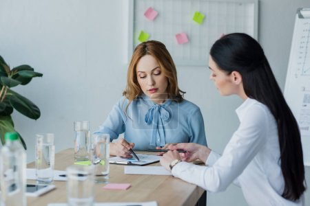 businesswomen working on project together at workplace in office