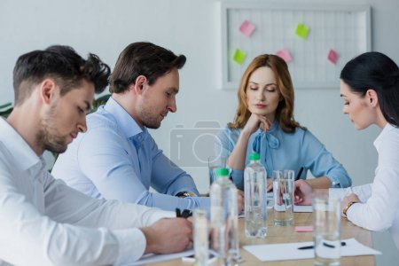 Photo for Selective focus of focused business people at workplace in office - Royalty Free Image