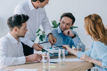 group of business people working on business plan at workplace in office