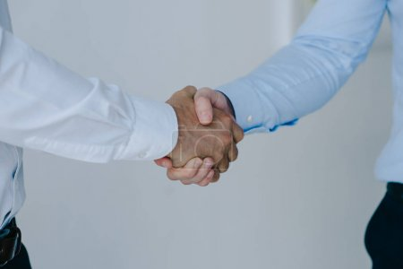 cropped shot of businessmen shaking hands together