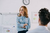 selective focus of pensive businesswoman at white board and colleague in office