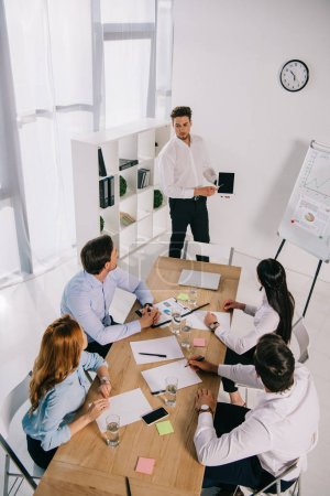 Photo for High angle view of business coworkers having business training in office - Royalty Free Image