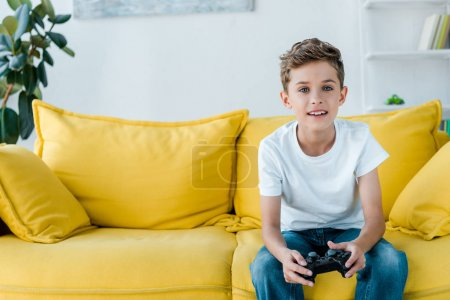 Photo for KYIV, UKRAINE - OCTOBER 2, 2019: happy kid playing video game at home - Royalty Free Image