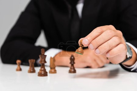 Photo for Cropped view of businessman in black suit playing chess - Royalty Free Image