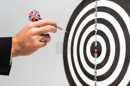 Photo for Cropped view of businessman playing darts isolated on grey - Royalty Free Image
