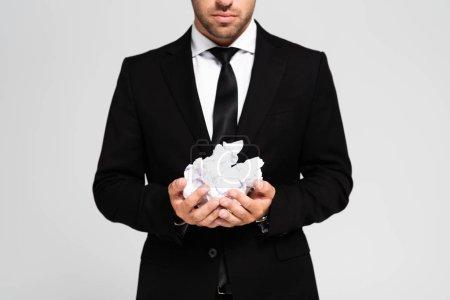 Foto de Vistas rotas de hombres de negocios vestidos con papeles triturados aislados en gris - Imagen libre de derechos