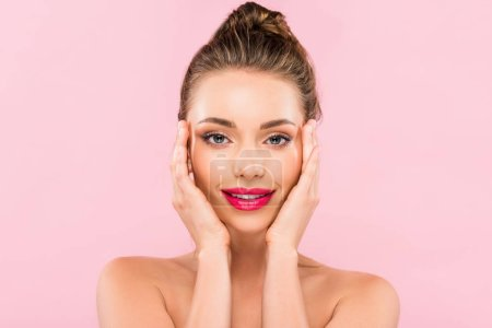 Photo for Naked beautiful woman with pink lips posing with hand on face isolated on pink - Royalty Free Image