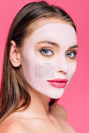 Photo pour Naked beautiful woman in facial mask isolated on pink - image libre de droit