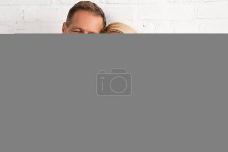 Photo for Smiling mature couple with closed eyes holding hands in bed - Royalty Free Image