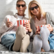 Selective focus on couple in 3d glasses with popco...