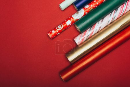 top view of wrapping paper rolls on red