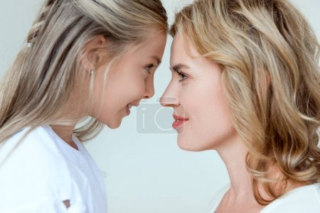 Photo for Side view of smiling mother looking at daughter isolated on grey - Royalty Free Image