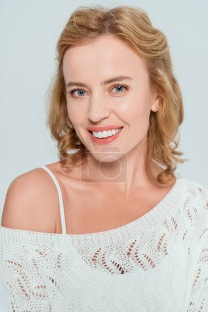 Photo for Attractive and smiling woman looking at camera isolated on grey - Royalty Free Image