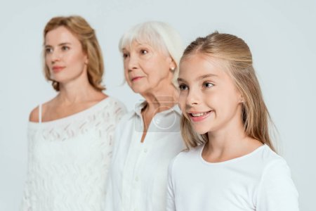 Photo for Selective focus of granddaughter, mother and grandmother on background isolated on grey - Royalty Free Image