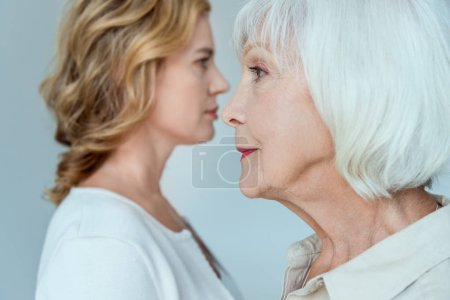 Photo for Selective focus of mother and daughter on background isolated on grey - Royalty Free Image