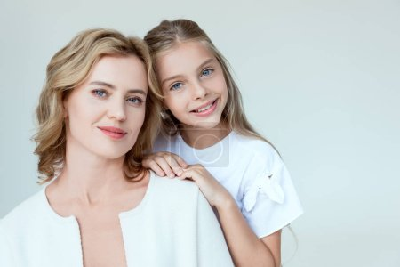 Photo for Attractive mother and smiling daughter looking at camera isolated on grey - Royalty Free Image
