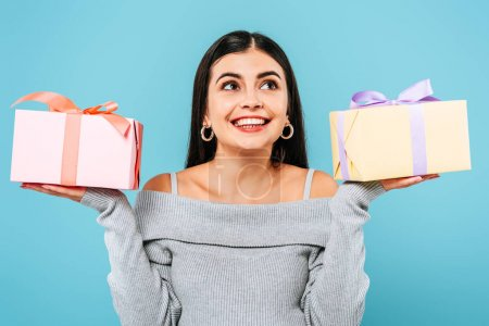 Photo for Smiling pregnant pretty girl holding presents isolated on blue - Royalty Free Image