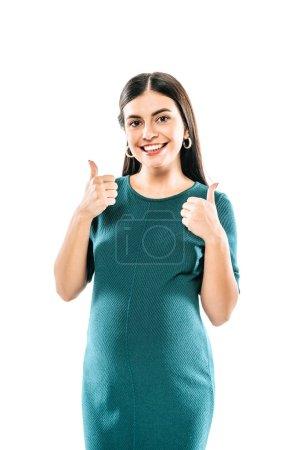 Photo pour Souriant fille enceinte montrant pouces vers le haut isolé sur blanc - image libre de droit