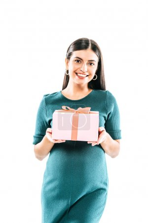 smiling pregnant girl holding present isolated on white