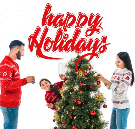 Photo for Happy daughter decorating christmas tree near parents isolated on white with happy holidays illustration - Royalty Free Image