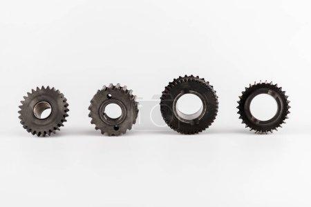 Foto de Metal round gears in row on white background - Imagen libre de derechos