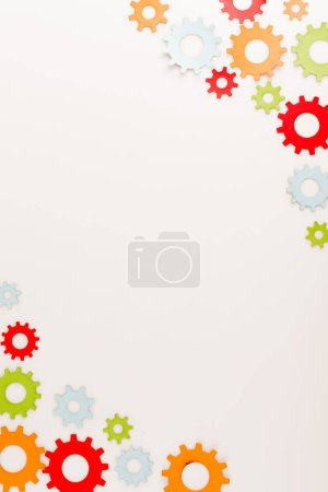 Photo for Top view of multicolored gears isolated on white with copy space - Royalty Free Image