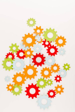 Photo pour Top view of multicolored gears isolated on white - image libre de droit
