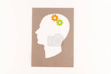 top view of human head silhouette with gears isolated on white