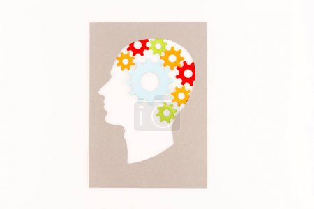 Photo pour Top view of human head silhouette with gears isolated on white - image libre de droit