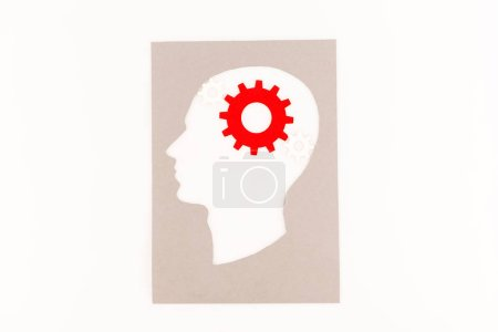 Photo for Top view of human head silhouette with red gear isolated on white - Royalty Free Image