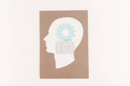 top view of human head silhouette with blue gear isolated on white