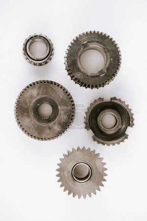 Photo for Top view of metal round gears on white background - Royalty Free Image