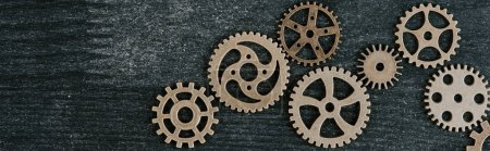 Photo for Top view of retro metal gears on dark wooden background with copy space, panoramic shot - Royalty Free Image