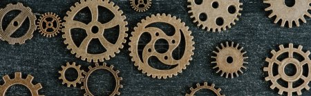 Photo for Top view of vintage metal gears on dark wooden background, panoramic shot - Royalty Free Image