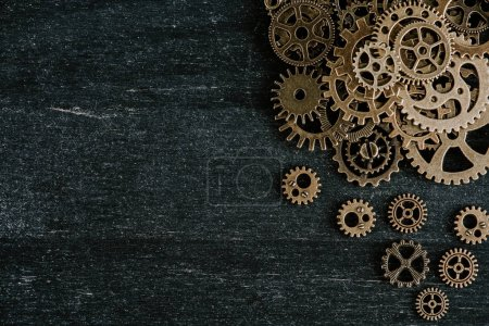 Photo for Top view of vintage metal gears on dark wooden background - Royalty Free Image
