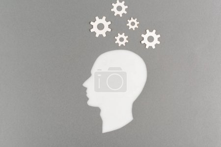 Photo for Top view of cut out white human head with gears isolated on grey - Royalty Free Image